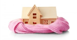 image of a home wrapped in a blanket - Southern NH Home Needs HVAC Service