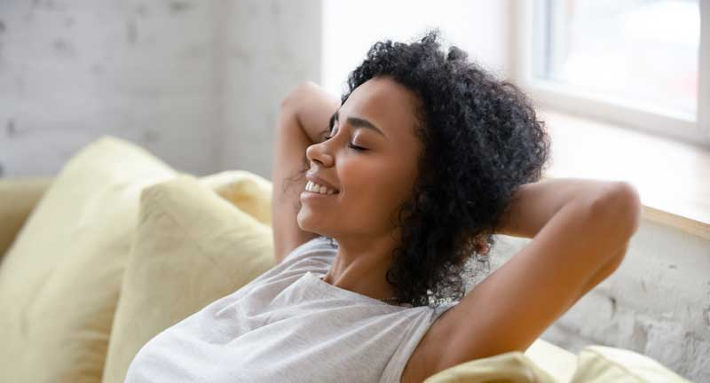woman relaxing in air conditioning